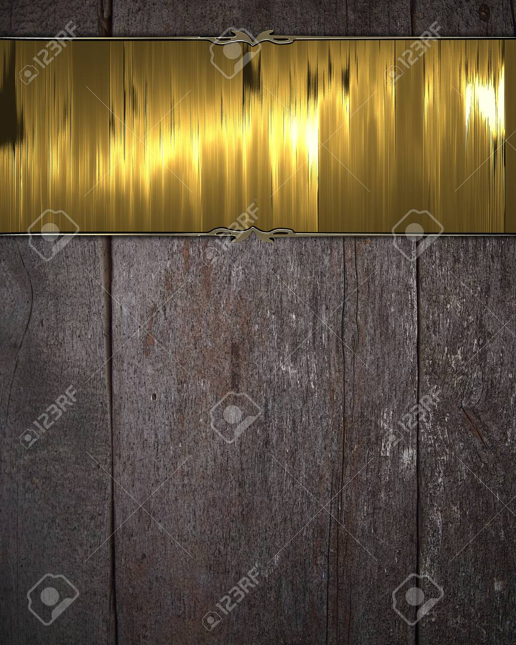 gold metal plate on wooden background Stock Photo - 18973369