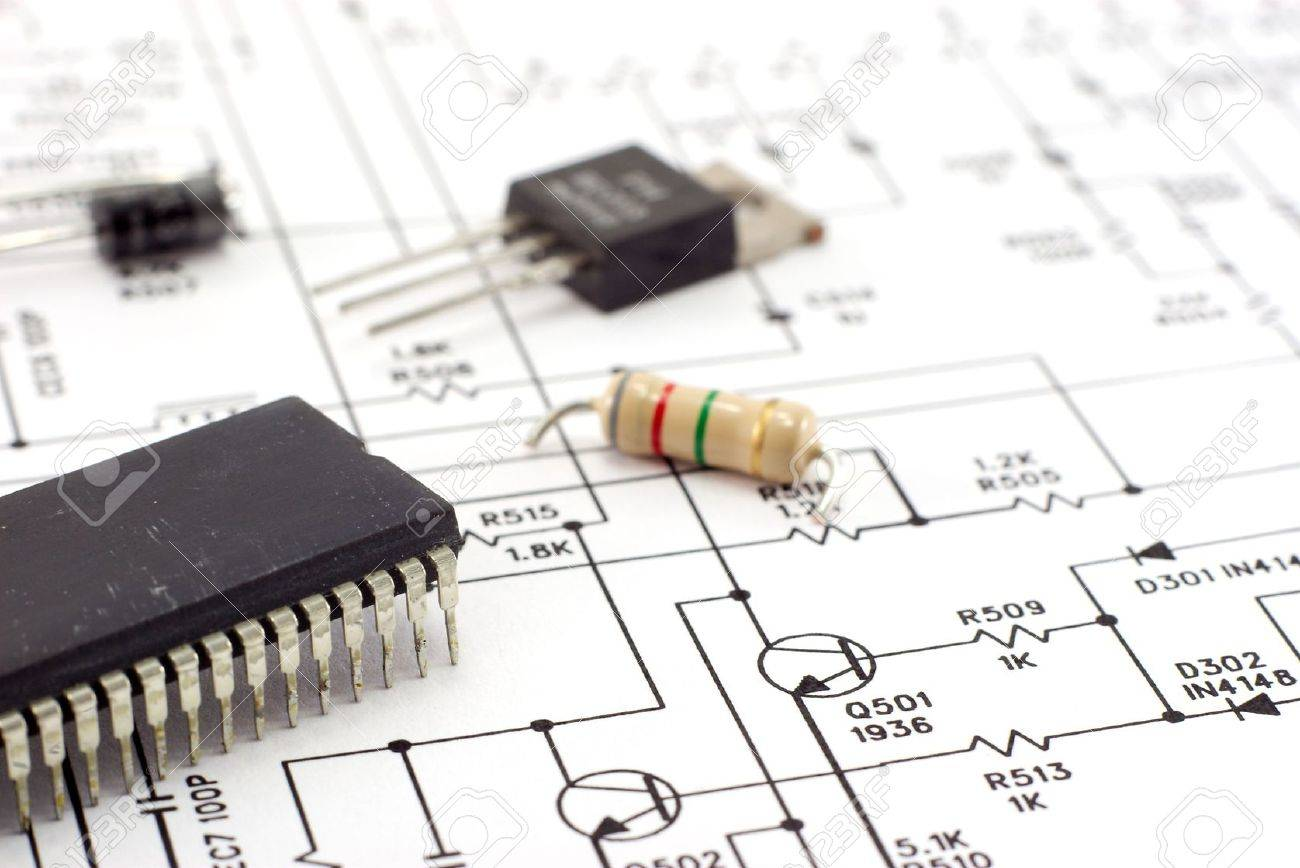 Electronic Components On A Schematic Diagram Background. Stock Photo ...