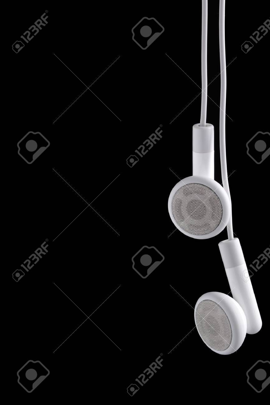 Modern portable audio ear phones on a black background. Stock Photo - 5250870