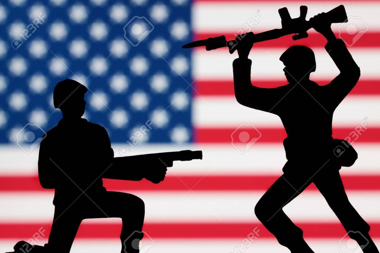 Two Toy Soldiers Battling On An American Flag Background. Stock ...