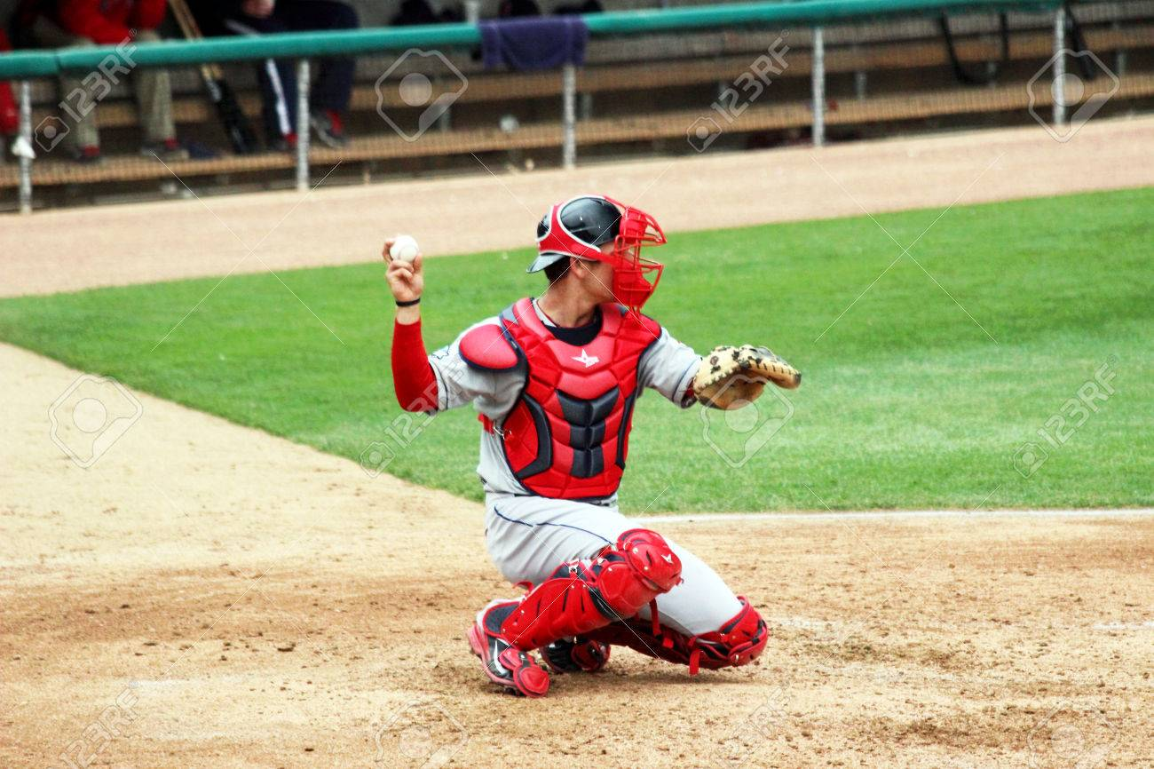 A Baseball Catcher Throwing A Baseball Back To The Pitcher Stock