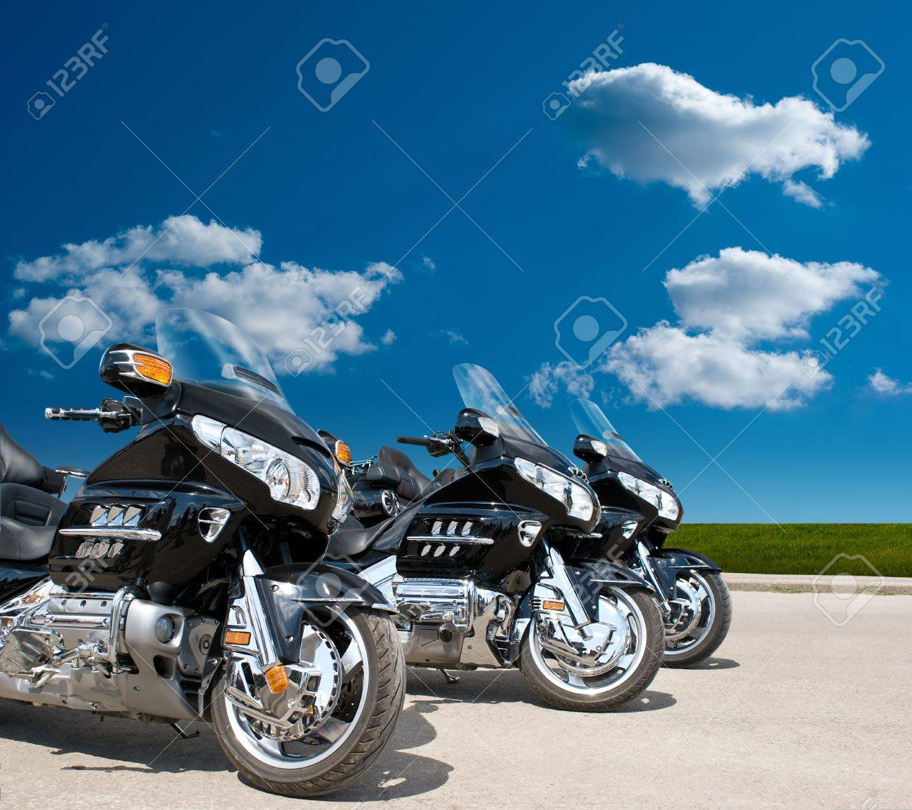 front view of Three Motorcycles on a road - 5603450