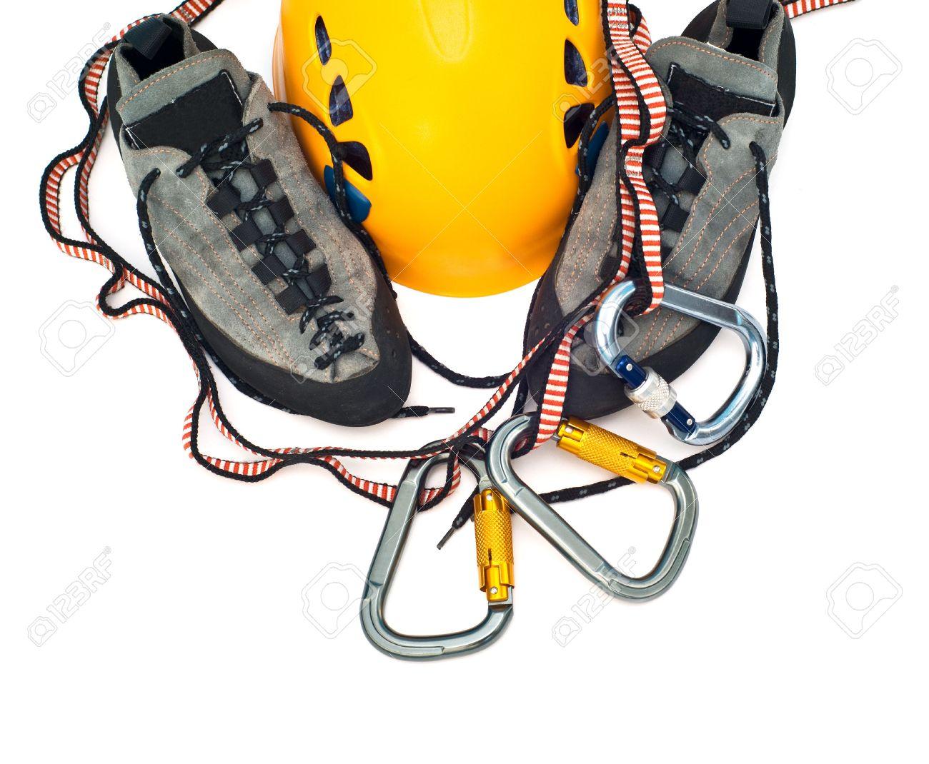 climbing gear - carabiners, orange helmet, rope, grey shoes Stock Photo - 5637474