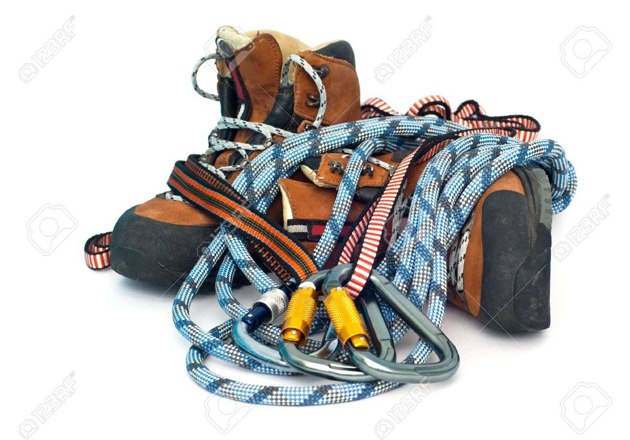 climbing and hiking gear - three carabiners, ropes and leather brown boots - 5637503