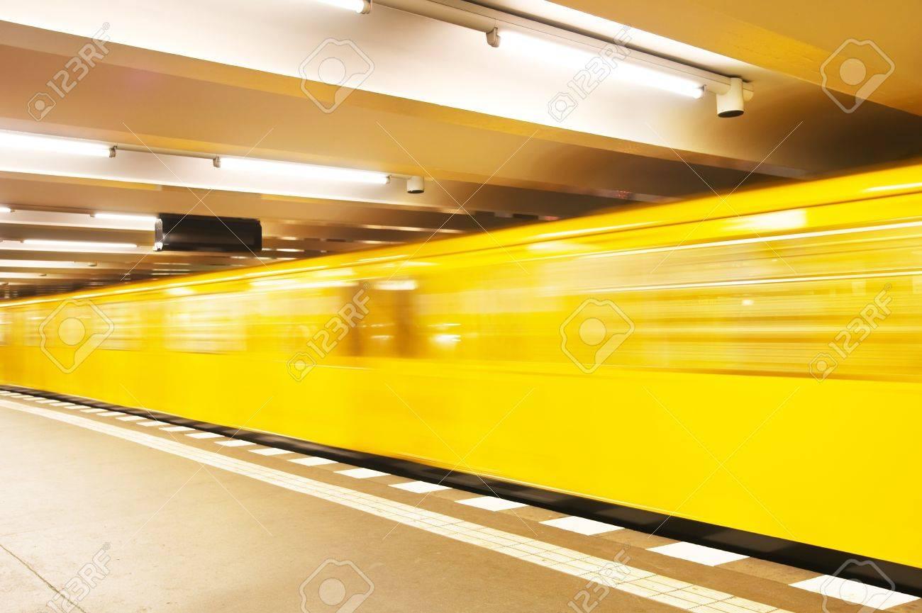 Yellow underground train in motion - 7989527
