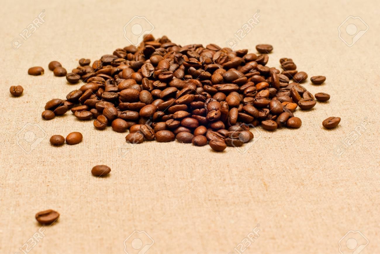 coffee grains on the burlap - 9344574