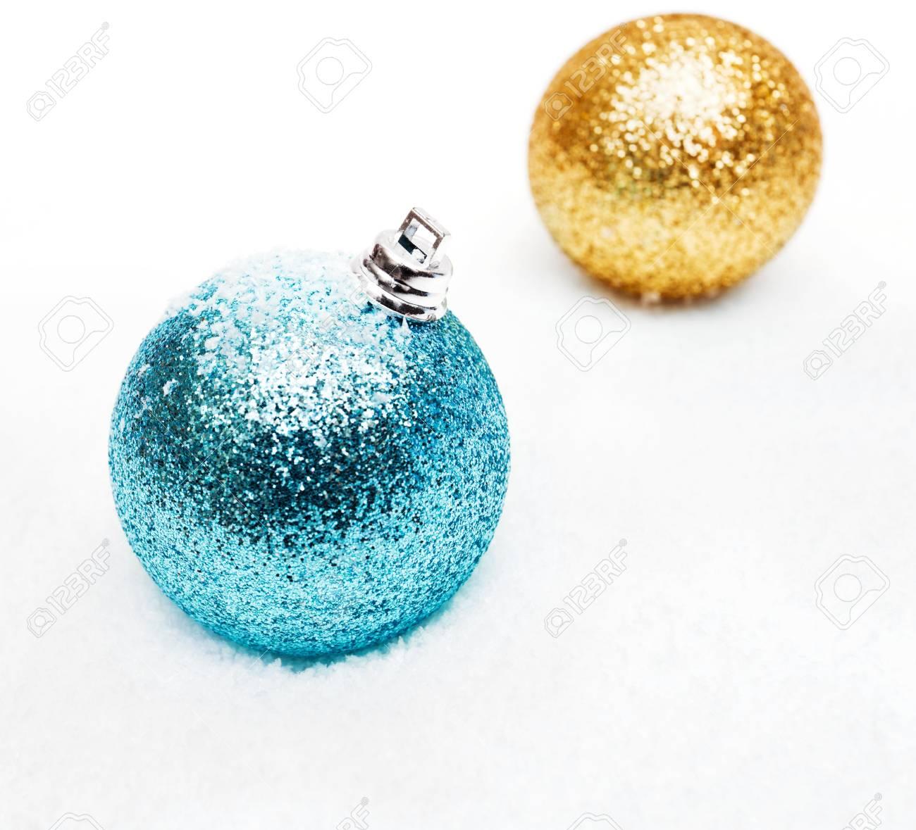 Christmas balls on the snow - 11230967
