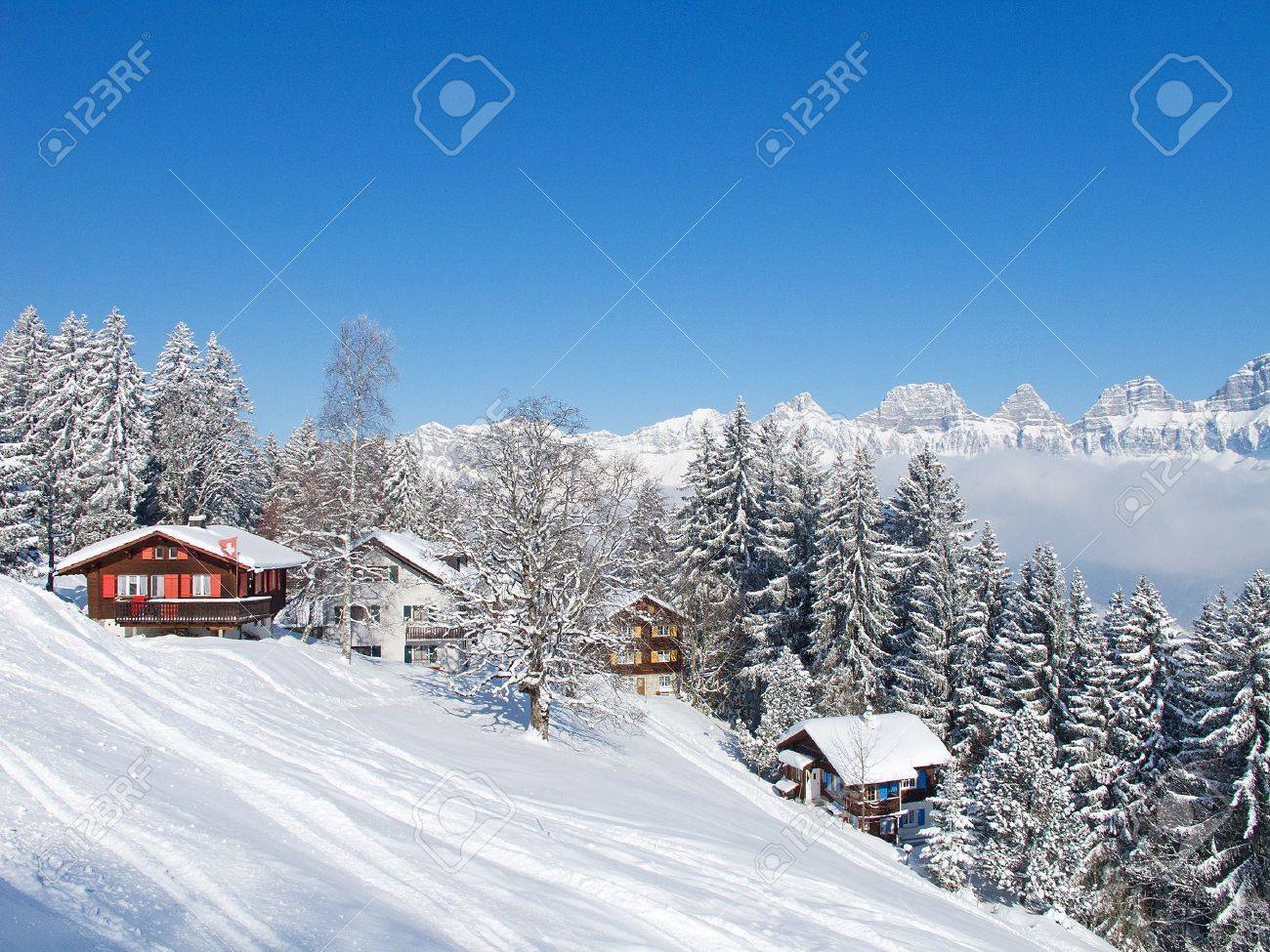 Winter holiday house in swiss alps Stock Photo - 8697386