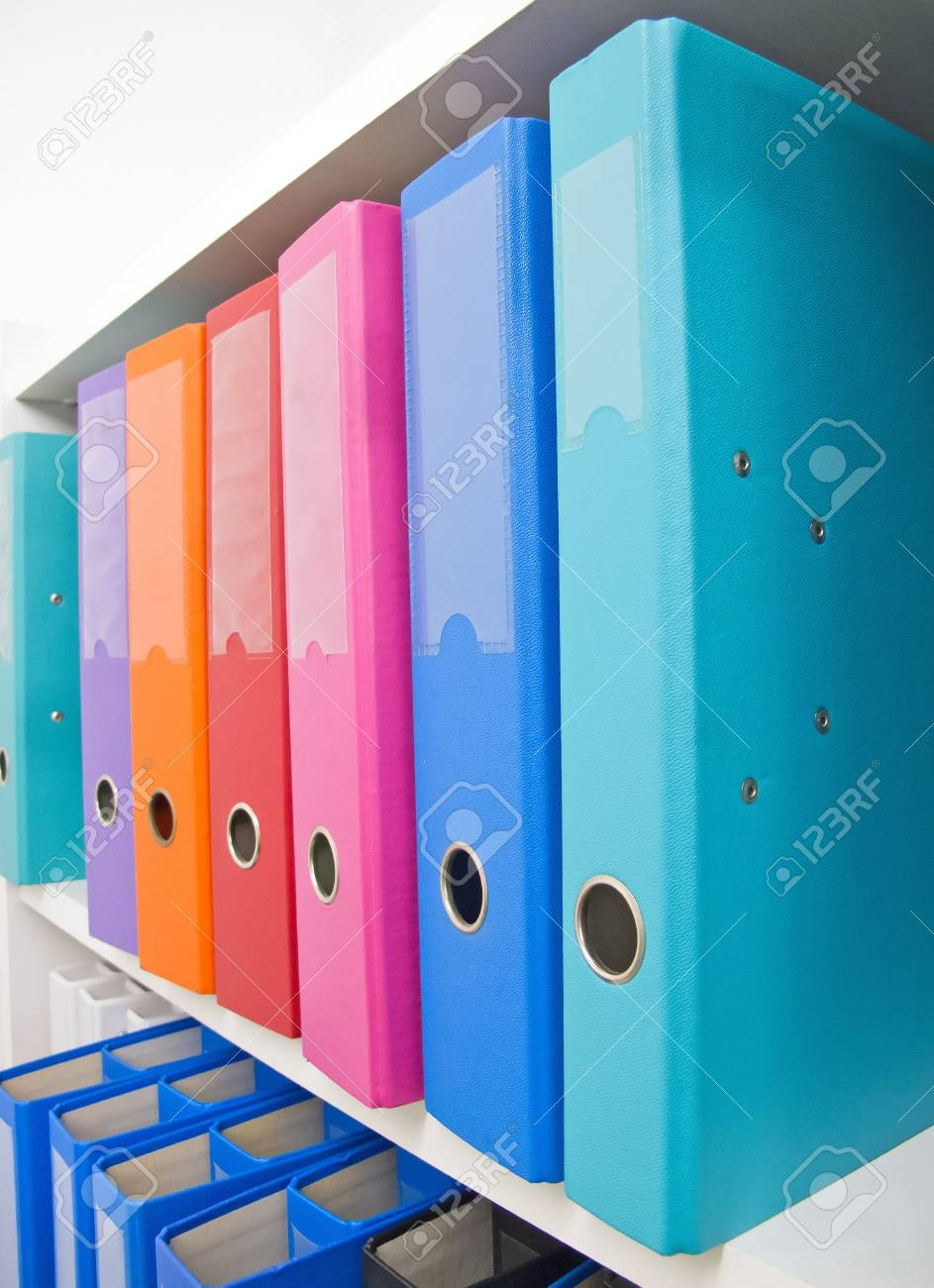 Colorful office folders on the bookshelf Stock Photo - 8780309