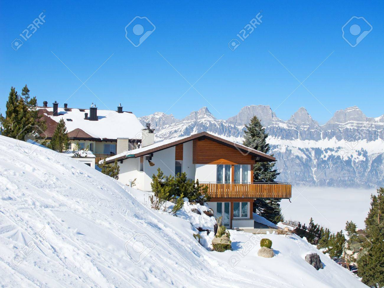 Swiss Mountain House winter holiday house in swiss alps stock photo, picture and