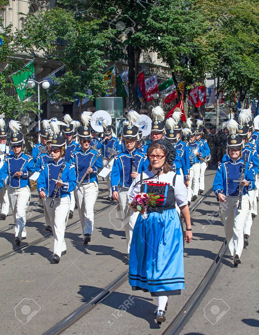 ZURICH - AUGUST 1: Zurich city orchestra in traditional costumes openning the Swiss National Day parade on August 1, 2009 in Zurich, Switzerland. Stock Photo - 15131964