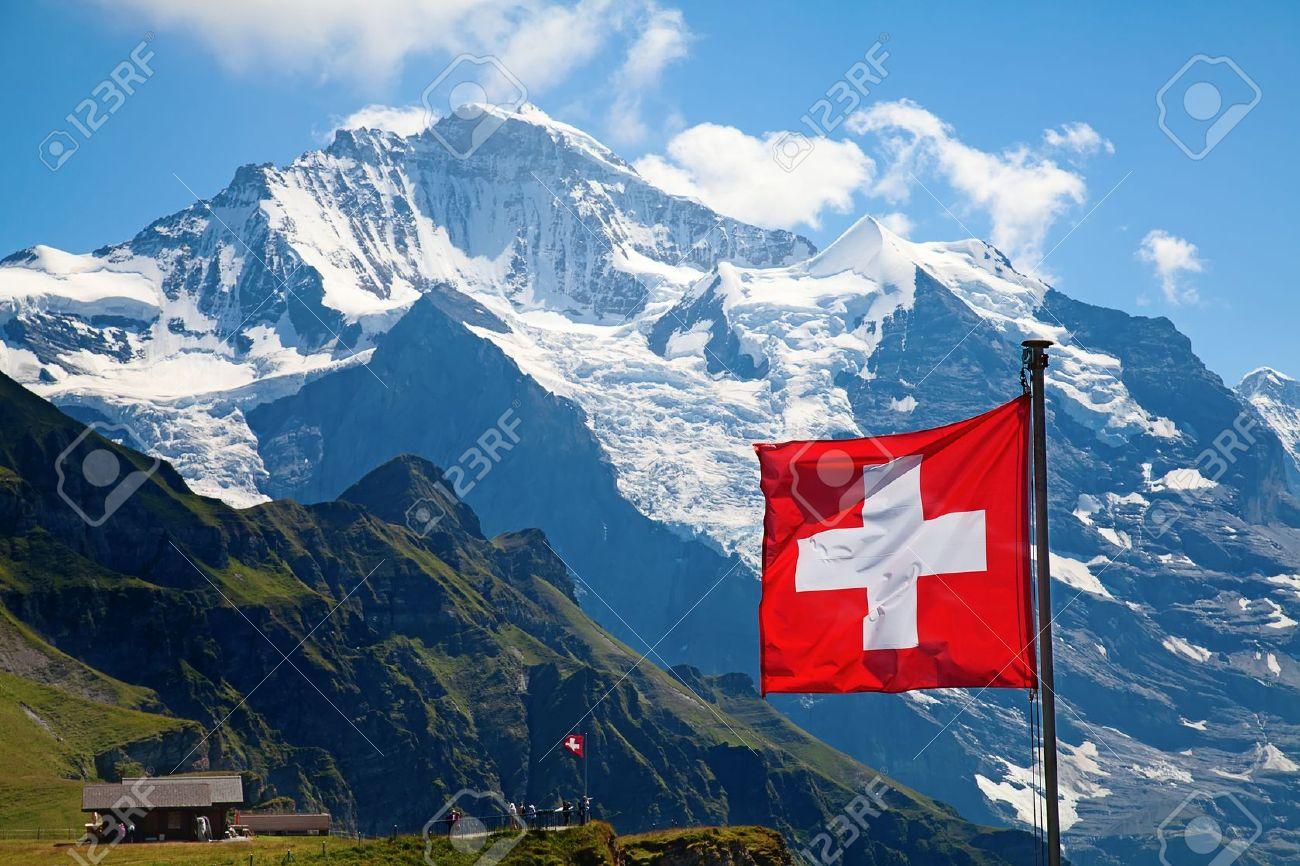 Swiss flag on the top of Mannlichen Jungfrau region, Bern, Switzerland - 18940779