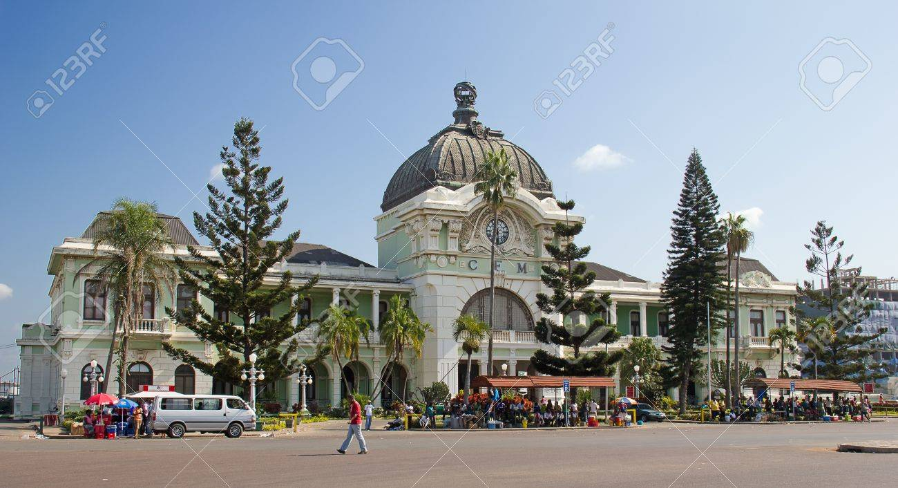 MAPUTO, MOZAMBIQUE - APRIL 29: Unidentified people on the street market near railway station in Maputo, Mozambique on April 29, 2012. The Maputo railway station is one the landmarks of the city - 19276304