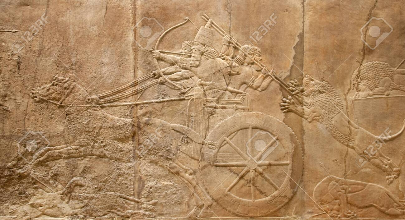 Ancient sumerian stone carving with cuneiform scripting - 153973696