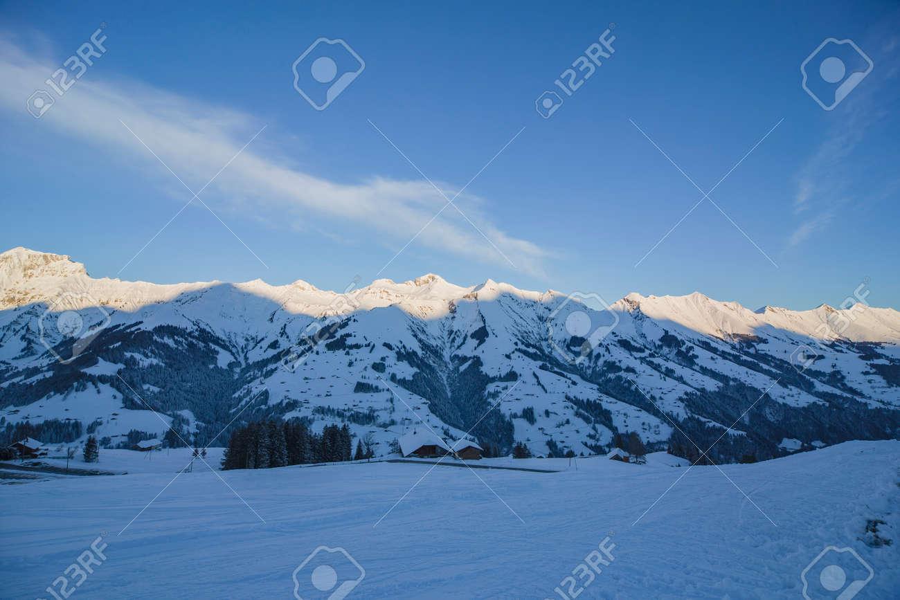 Sunrise in Adelboden region Elsigen Bernese Oberland in winter - 165972190