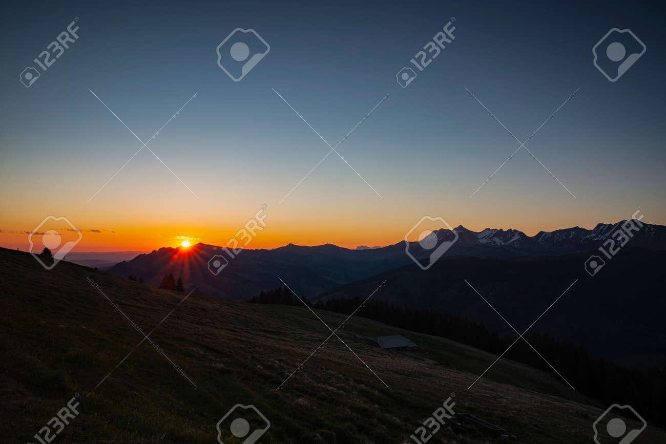 Sunrise over Friborg alps in Switzerland. Sunny blue sky. - 170452604