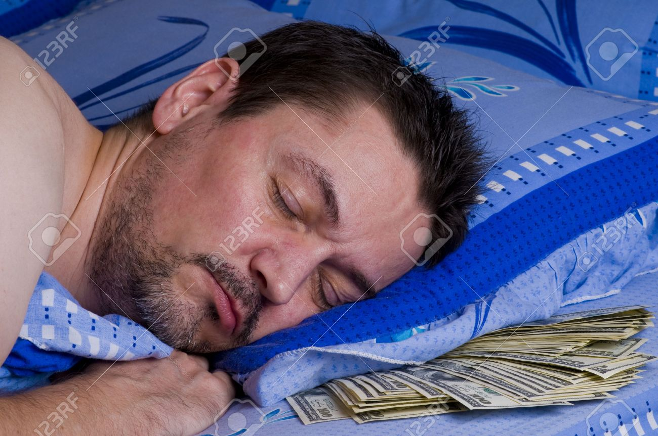 man sleeping with money under his pillow Stock Photo - 7507649