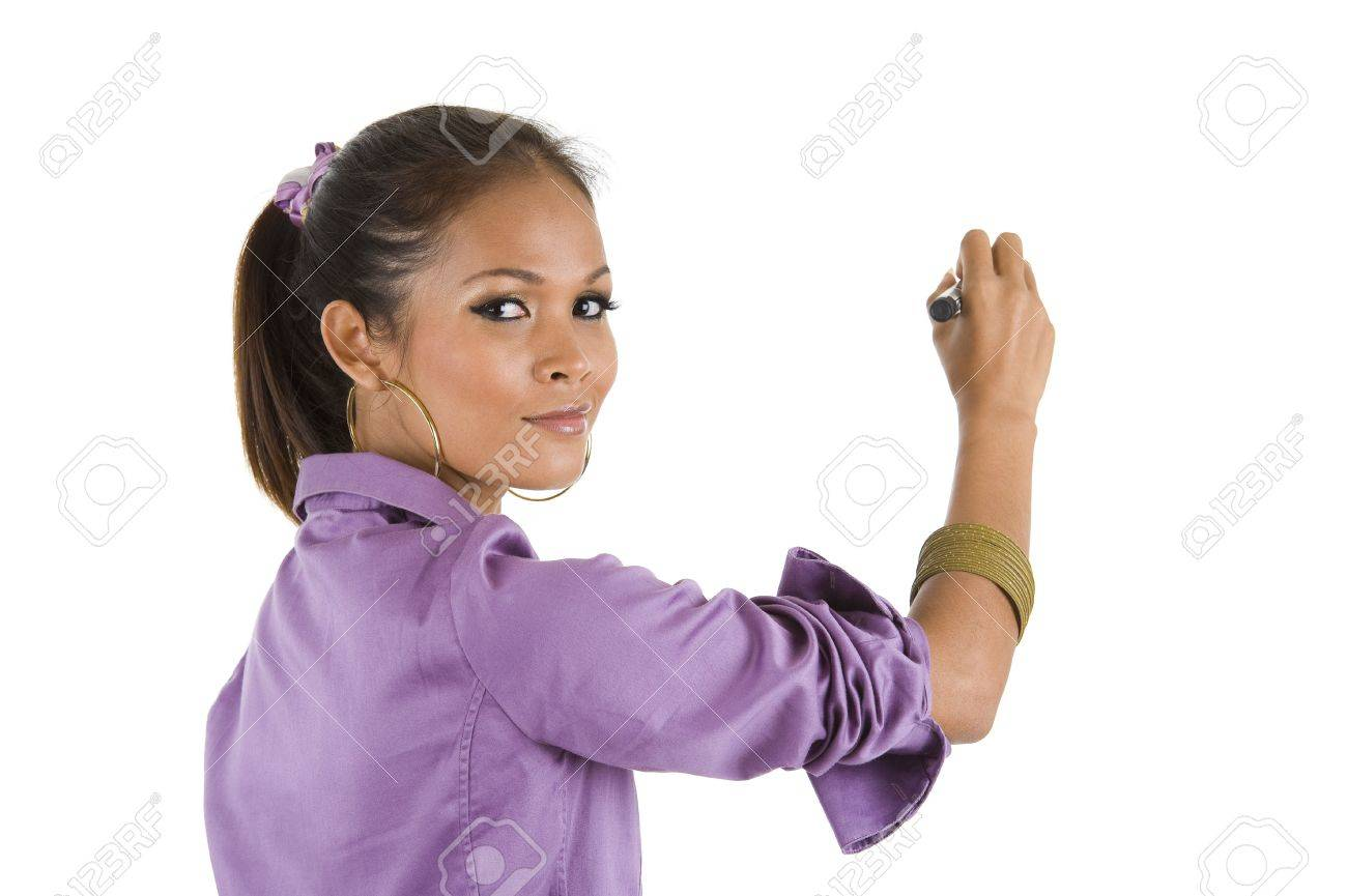 beautiful young woman looking back over her shoulder and writing whatever you want with a black marker, isolated on white background Stock Photo - 7806887
