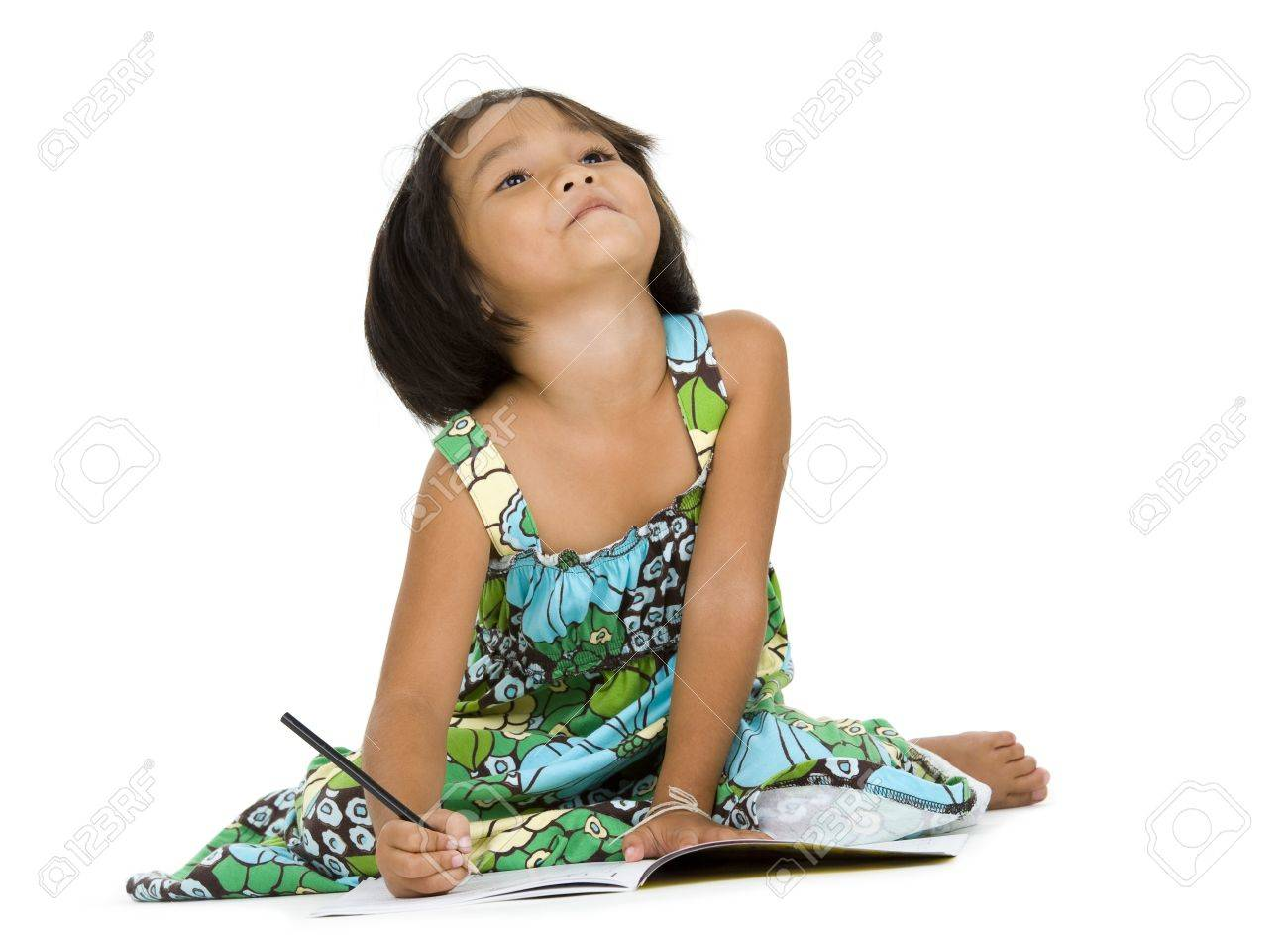 cute girl doing her homework, isolated on white background Stock Photo - 11800900