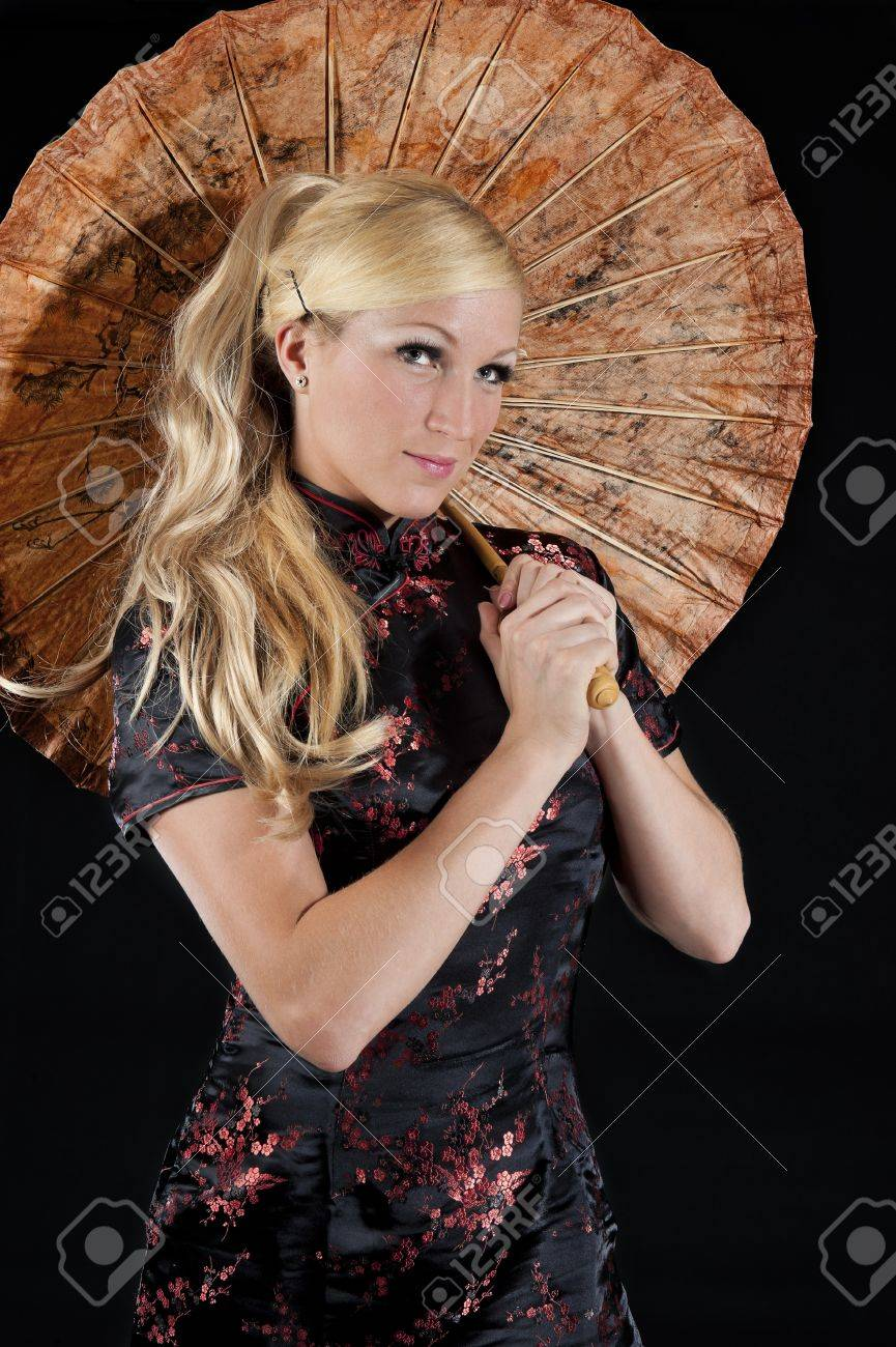 Beautiful Young Woman With Umbrella In Traditional Asian Dress