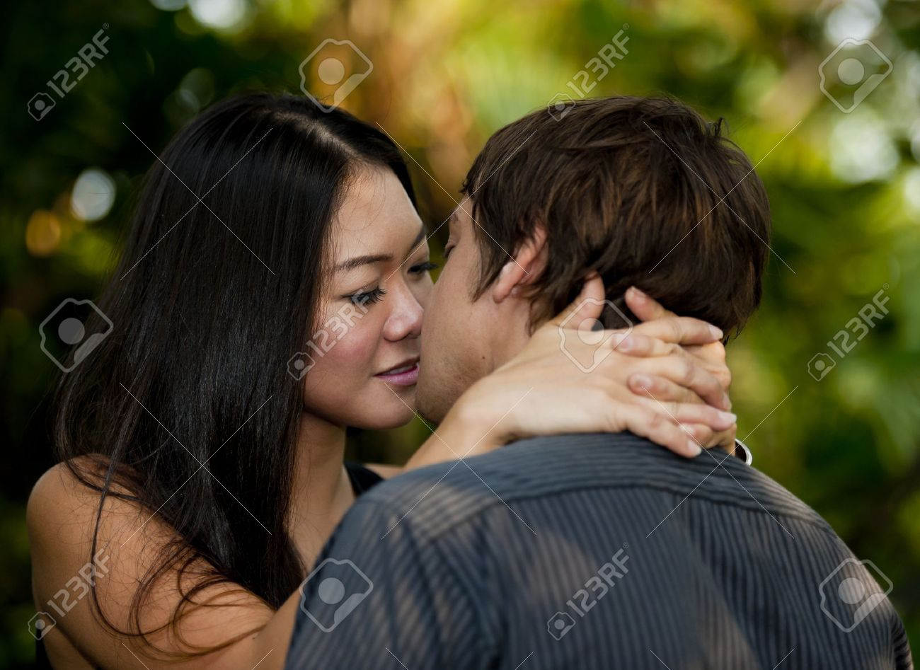 Asian ladies kissing