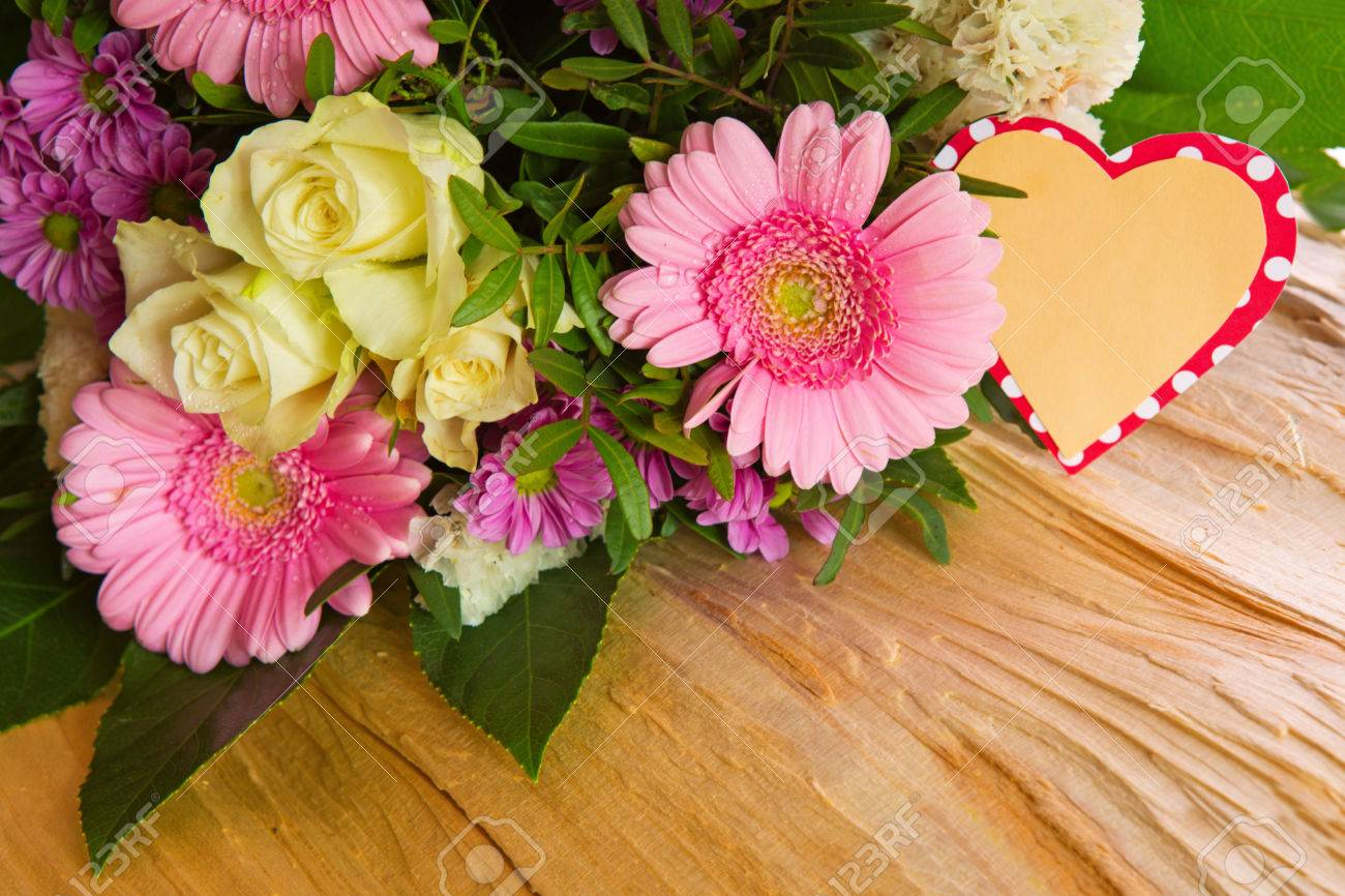 Colorful Fresh Flowers Bouquet Isolated On Wood Background And ...