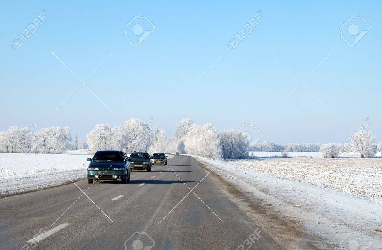 Three cars driving on a winter road - 5854940