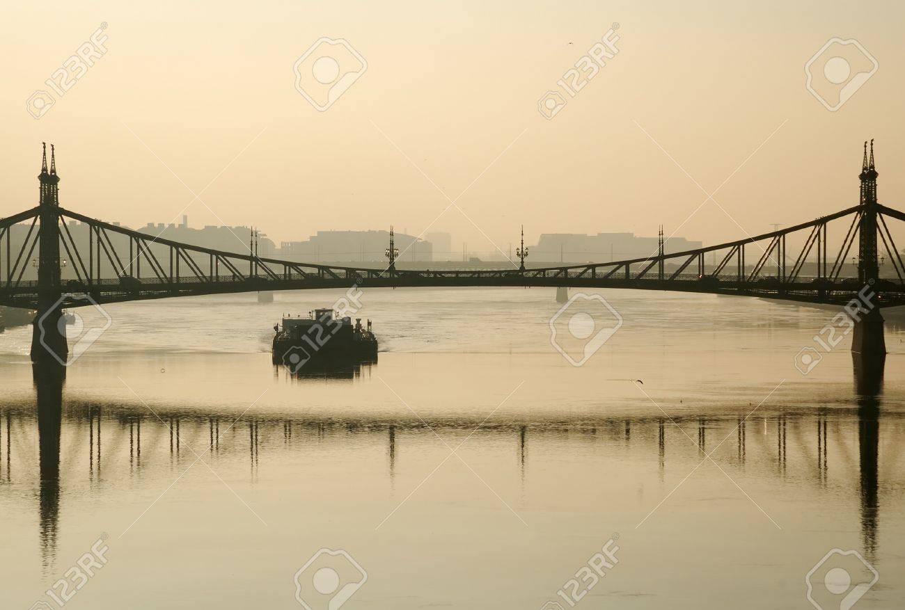 Budapest bridge and barge in morning haze - 7540961
