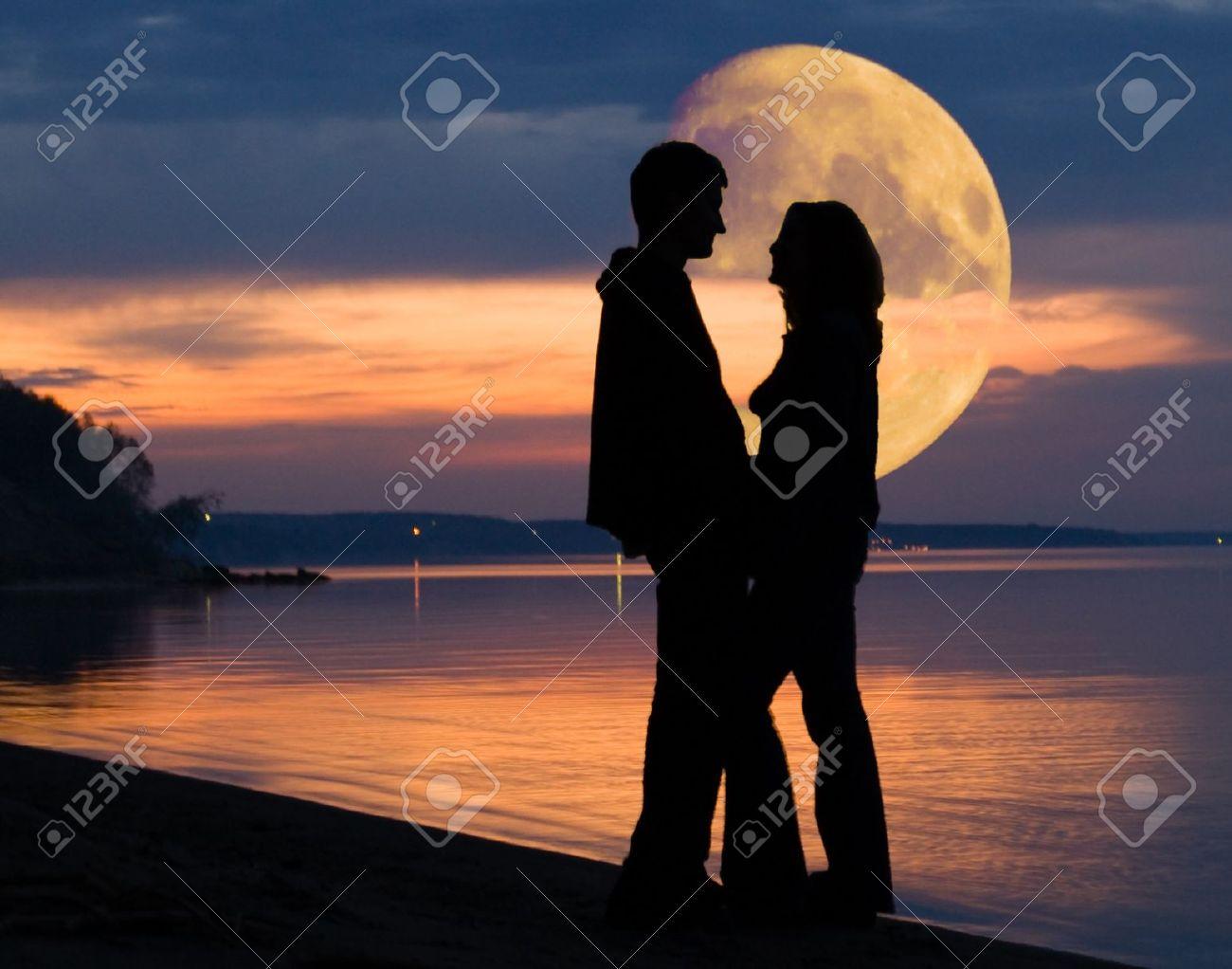 Romantic pair and huge Moon behind - 7687859