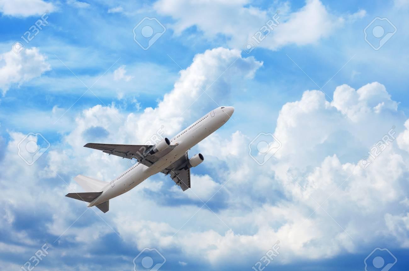 airplane in cloudscape - 9779094