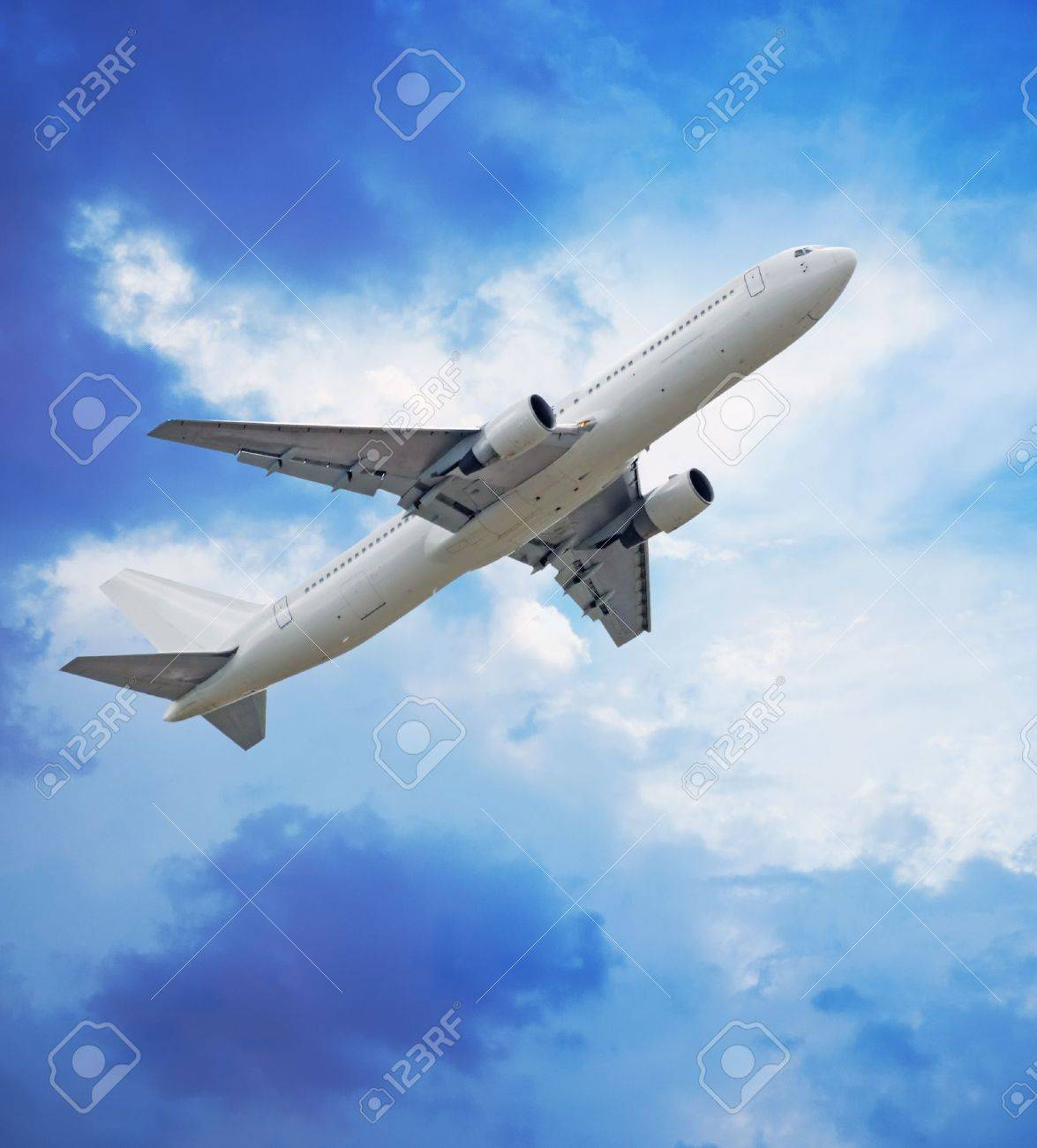 Passenger airliner in blue sky - 9779099