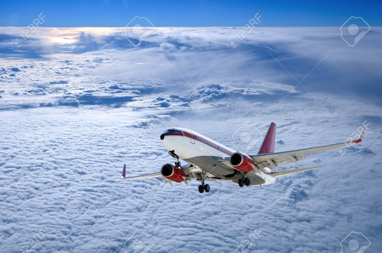 airplane in cloudscape with sunset above clouds Stock Photo - 13595006