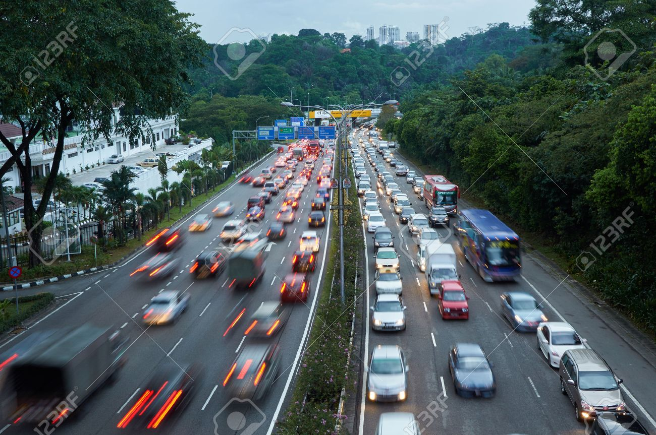 Evening traffic on the left driving road in Malaysia - 45565061