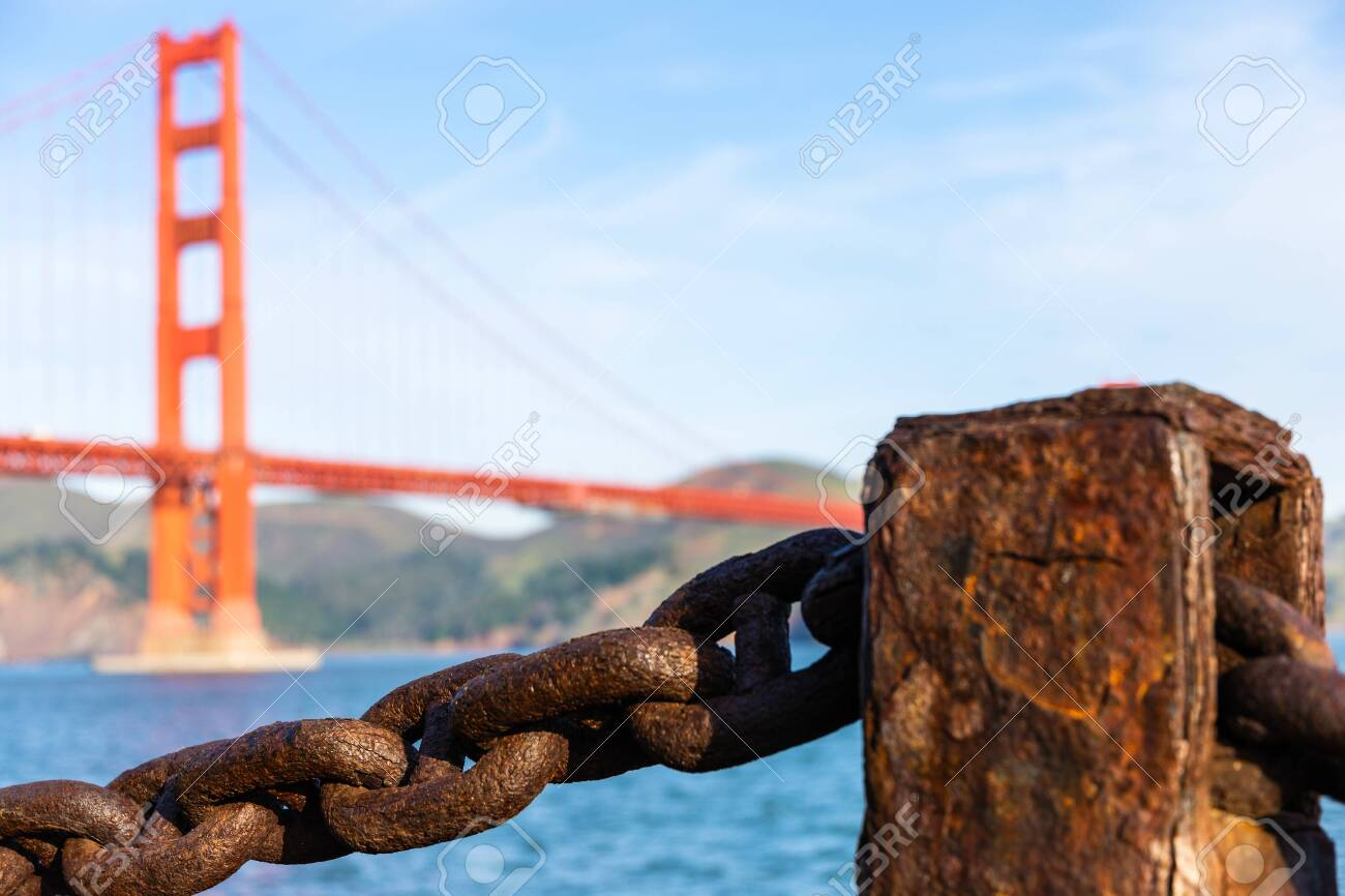 Old rusted chain in front of Golden Gate bridge in San Francisco - 124508029