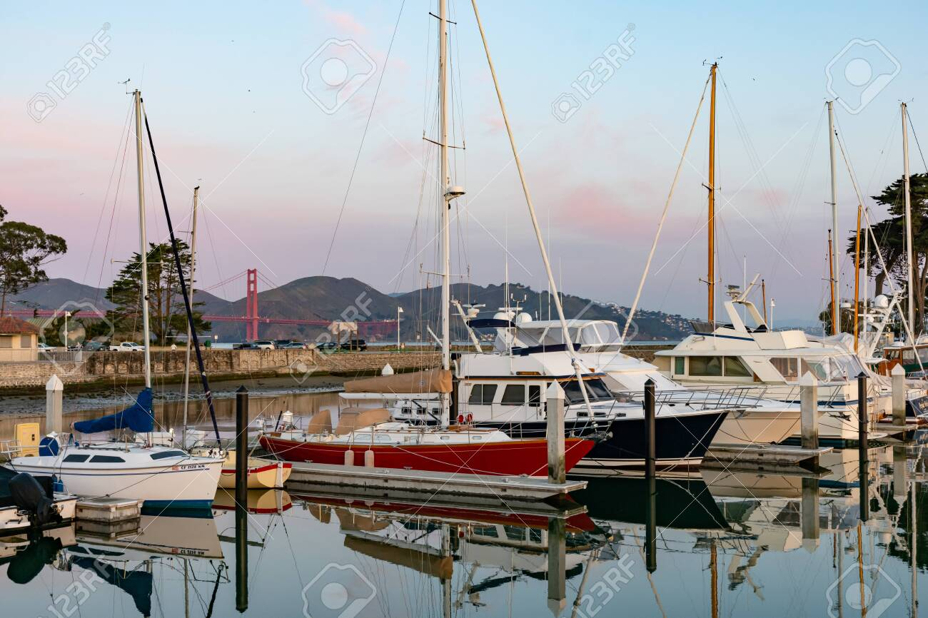 San Francisco, California / USA - Feb 7th 2019 - yachts in a marina in front of Golden Gate Bridge on February morning - 138674062