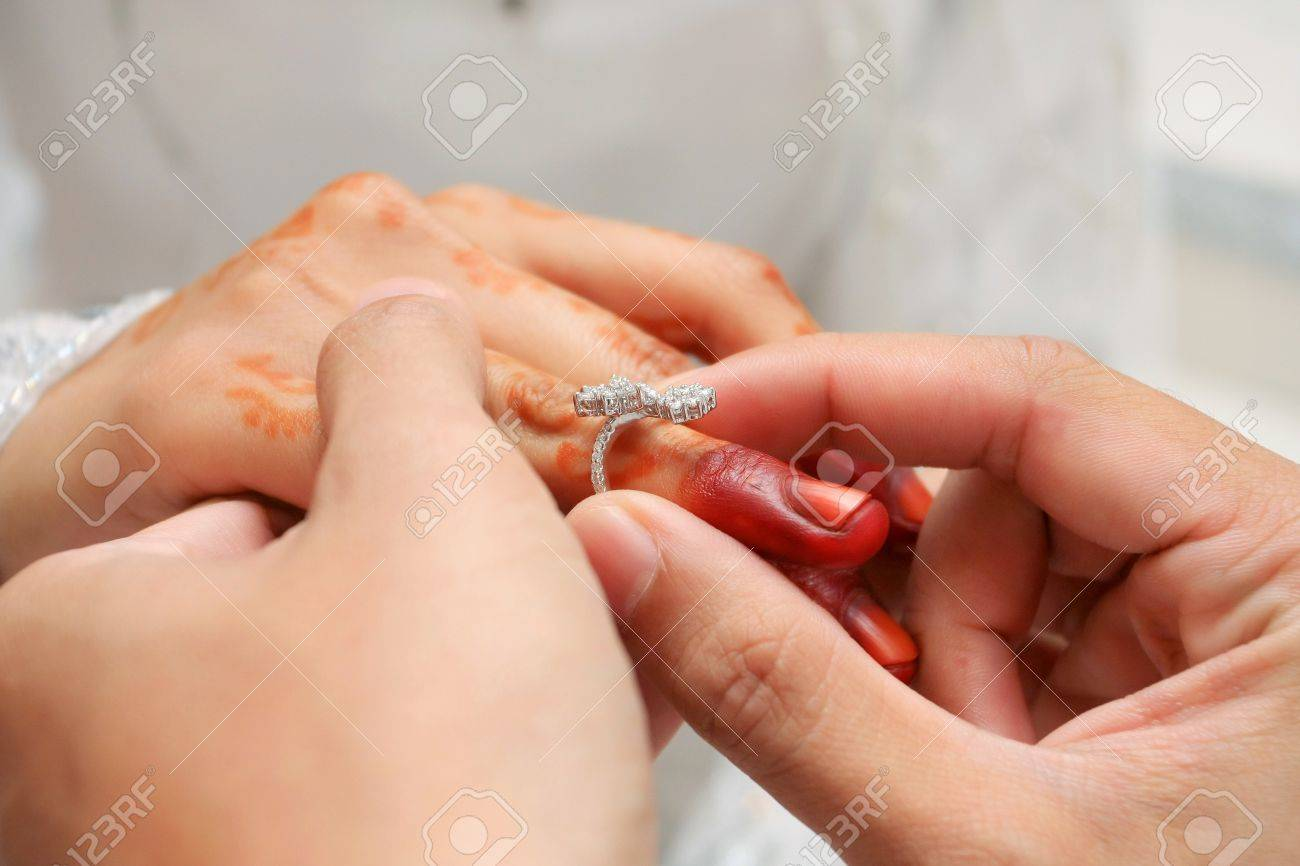 wear wedding ring ceremony in asian people stock photo 10735257