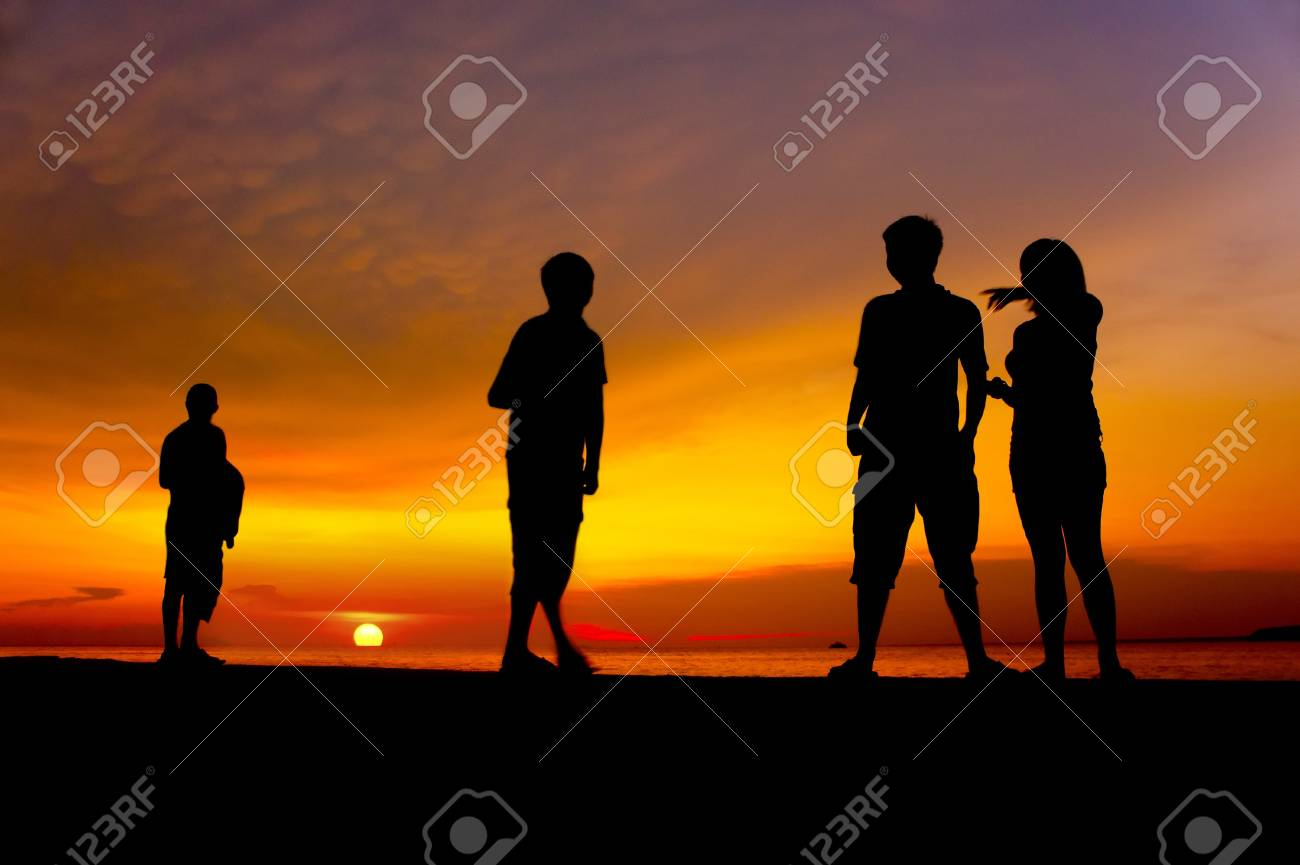 sunset with human silhouette and dramatic clouds Stock Photo - 14052627