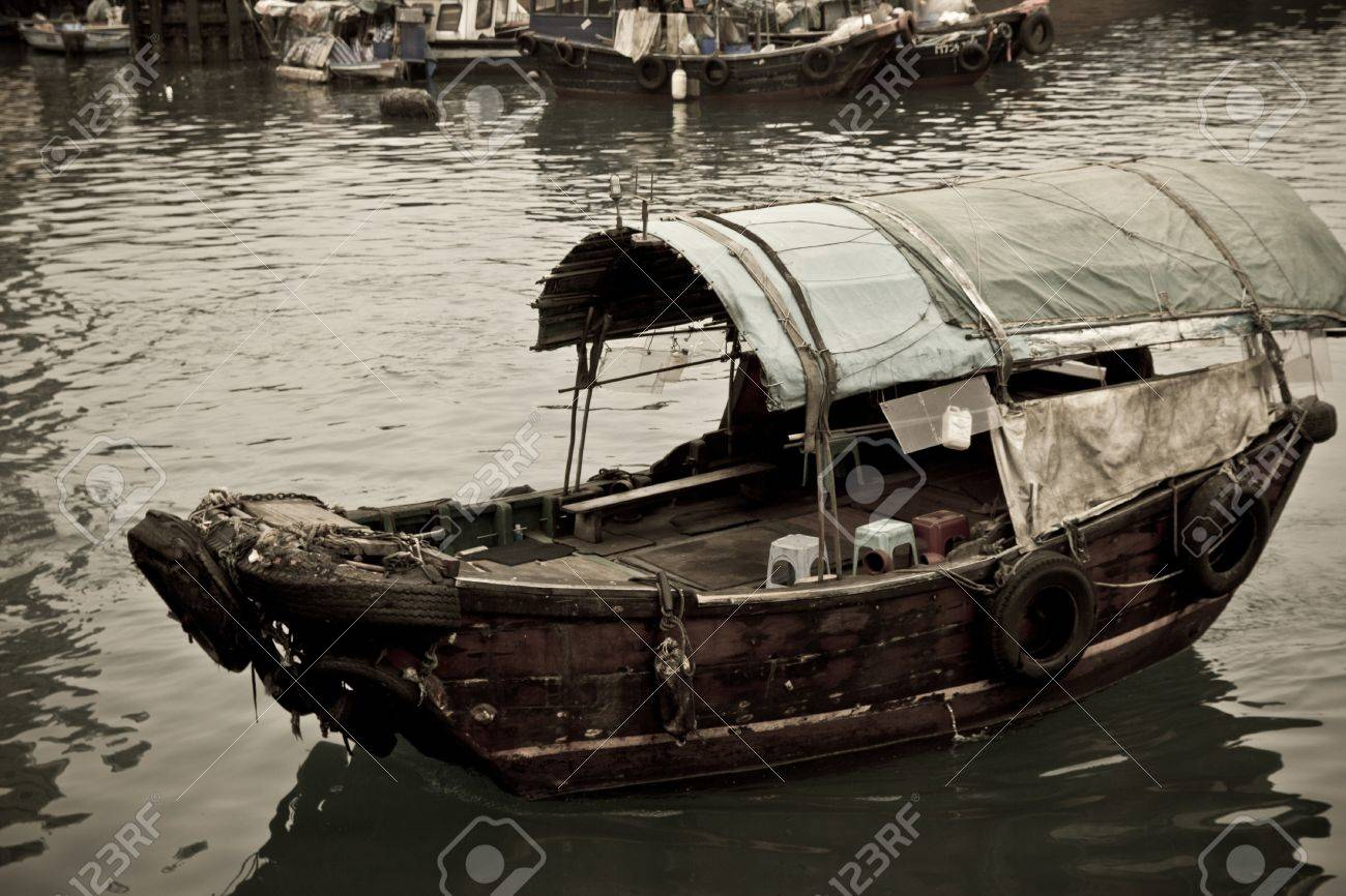 A Sampan boat floating in the sea in Hong Kong Typhoon Shelter Stock Photo - 9786276