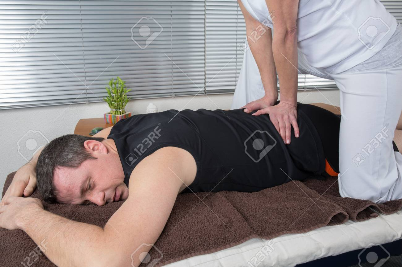 One man and woman performing back massage Stock Photo - 37137716