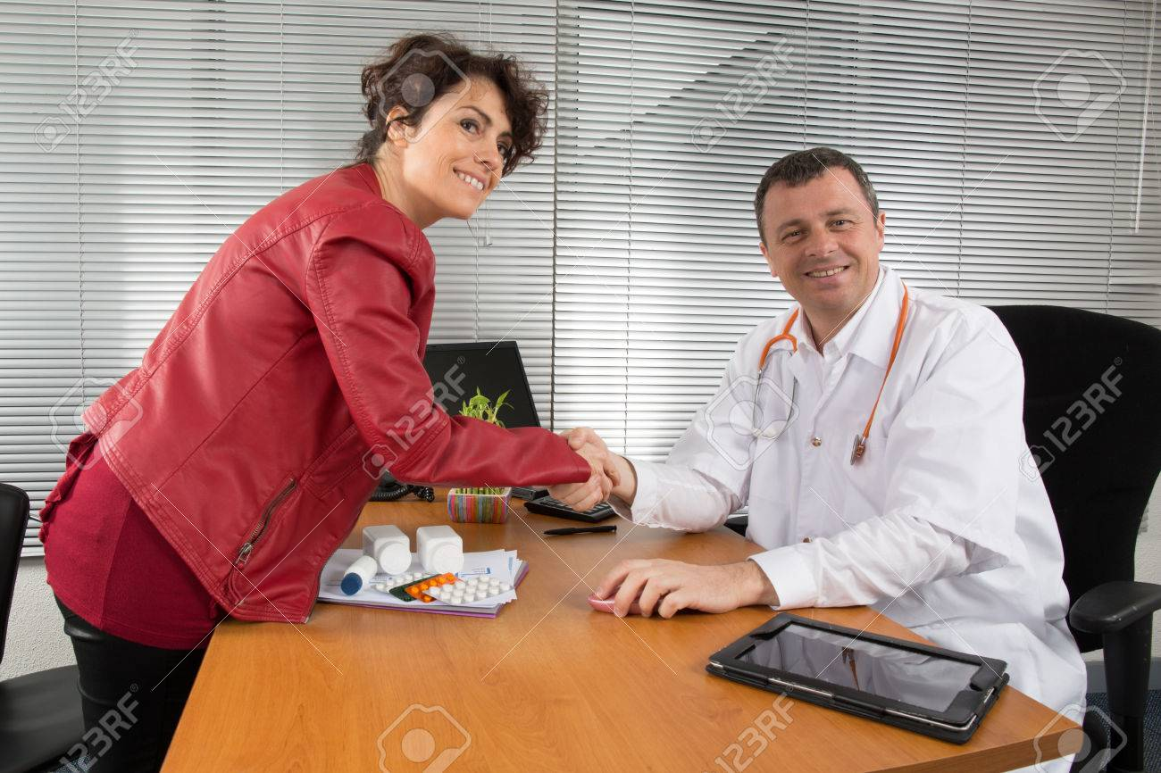 doctor receiving a w pharmaceutical s representative stock doctor receiving a w pharmaceutical s representative stock photo 38269163