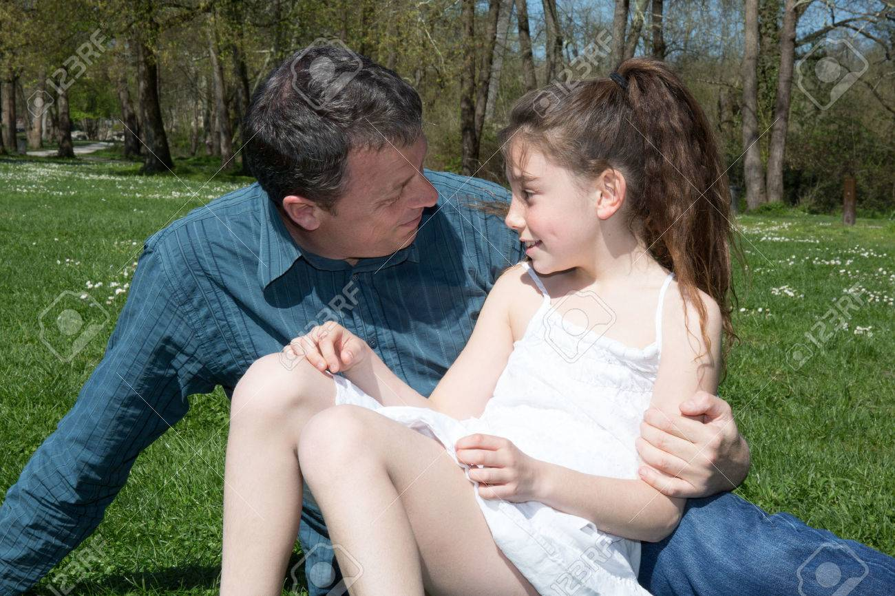 Girl, 10 Years Old With Her Father Outside Stock Photo, Picture ...