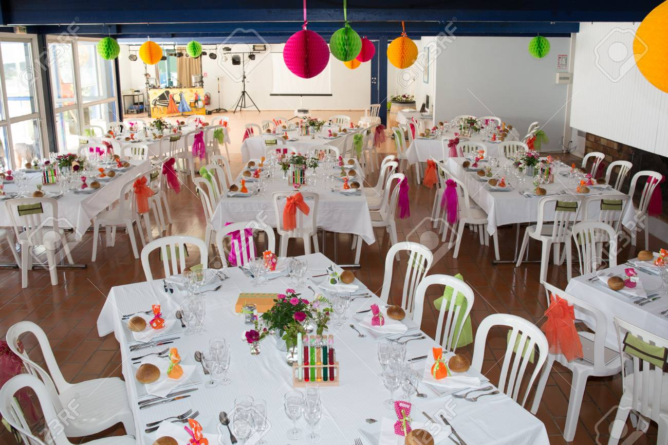Table Setting For An Wedding Reception In Orange Pink And Yellow
