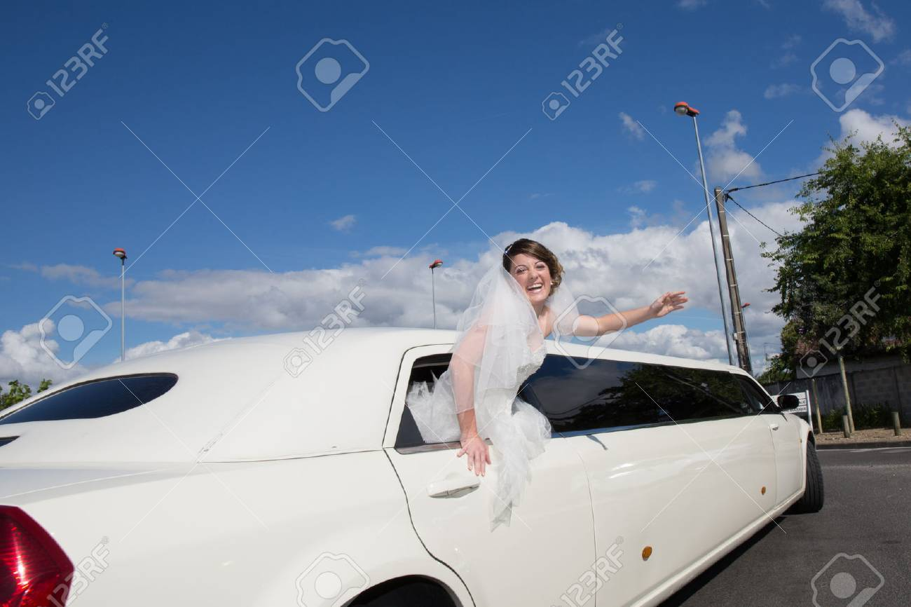 Luxury limo limousine with a bride under blue sky - 45157515
