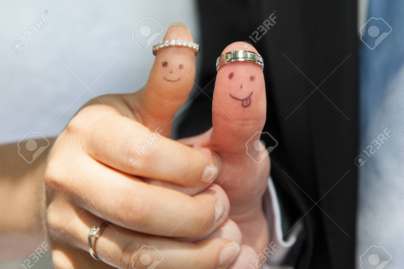 Wedding Rings On Their Fingers Painted With The Bride And Groom Stock Photo Picture And Royalty Free Image Image 45458593
