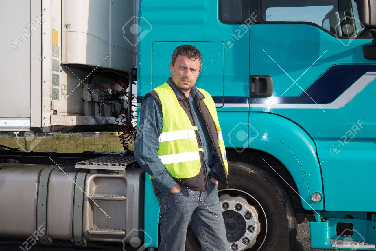 Serious and confident Man standing in front of truck - 47967079