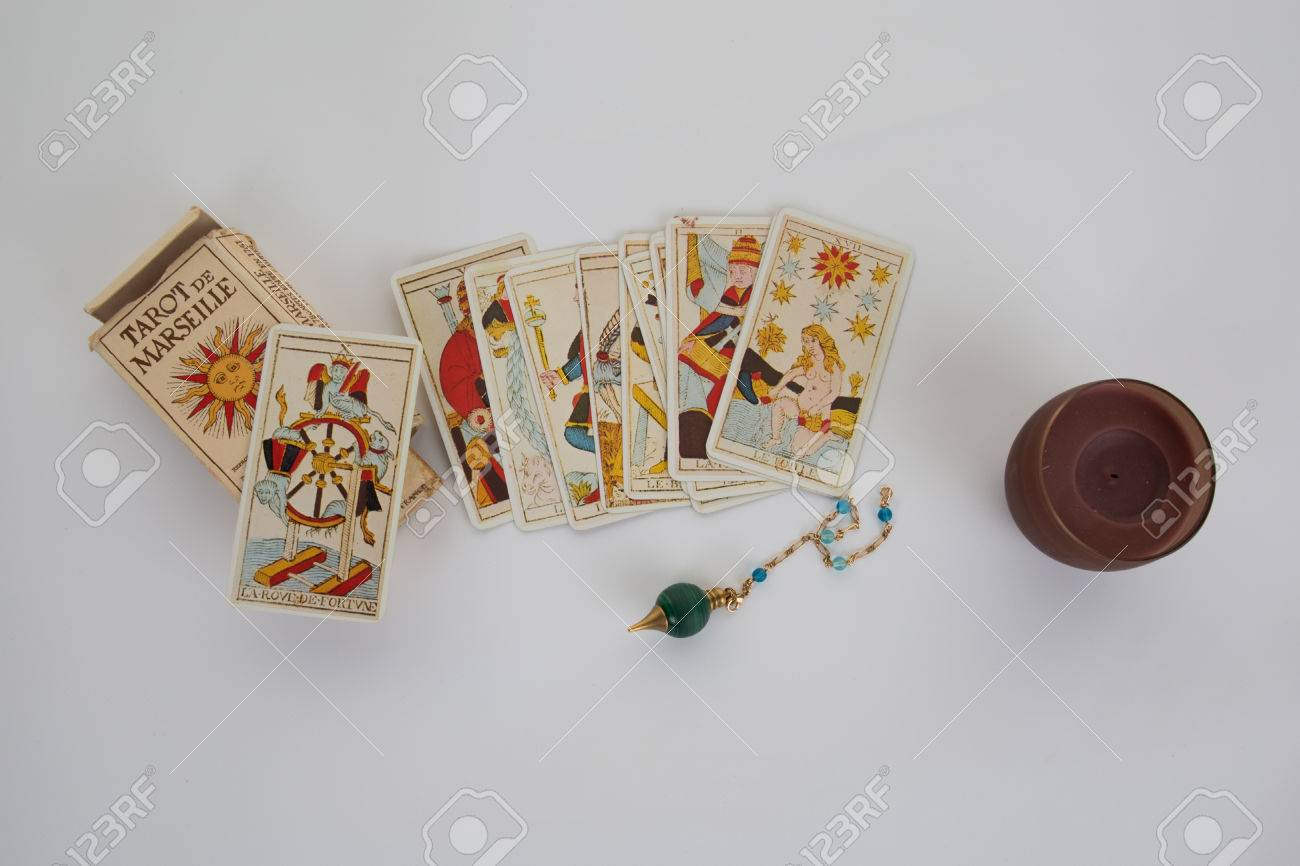 Tarot cards for a fortune -teller and pendulum isolated on white - 49059249