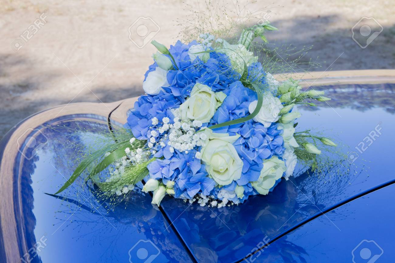 Wedding Car With Beautiful Decorations Of Blue Flowers