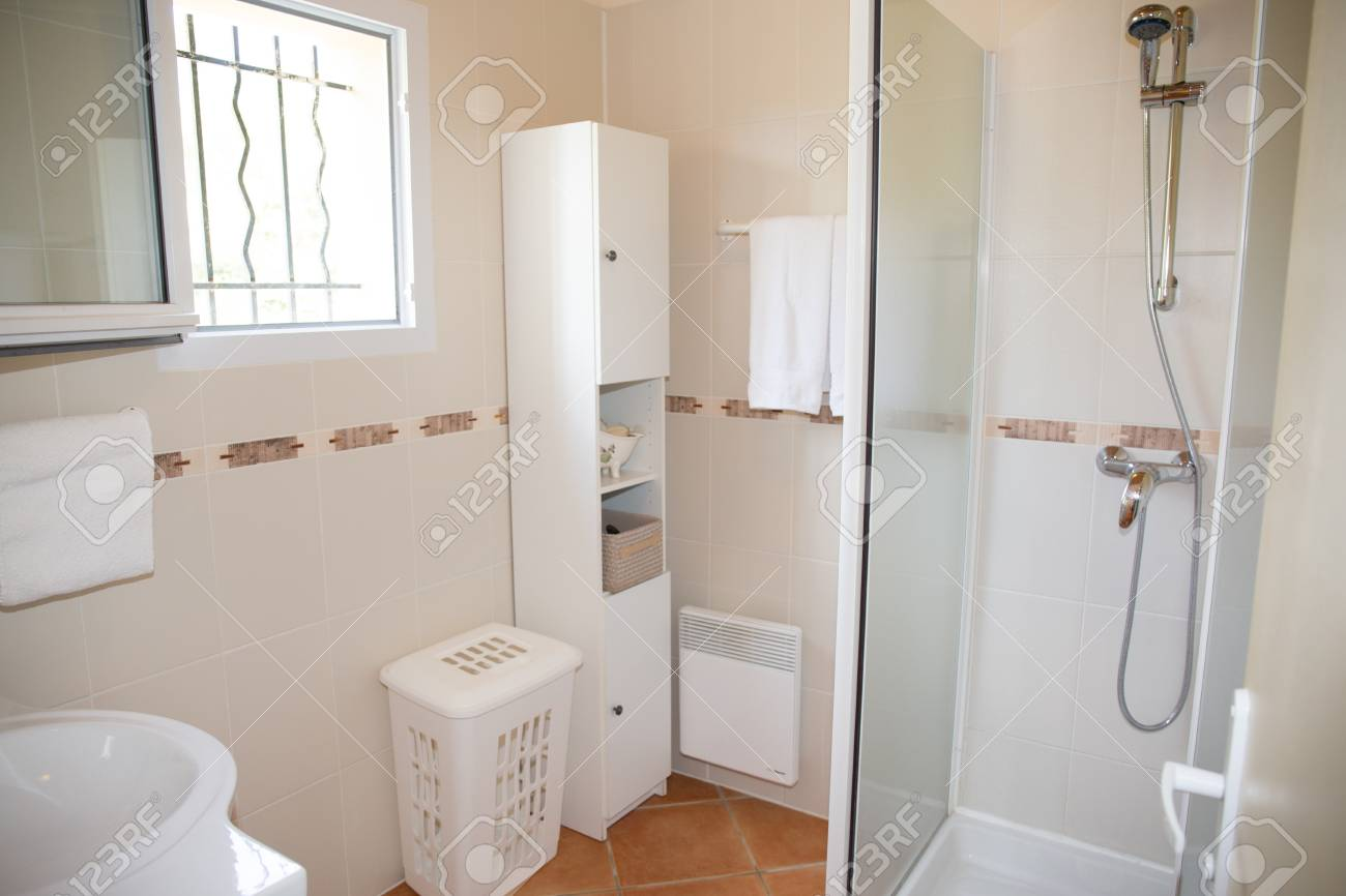 Modern Bathroom With White Ceramic Appliances And Shower Cabin Stock Photo    63537249