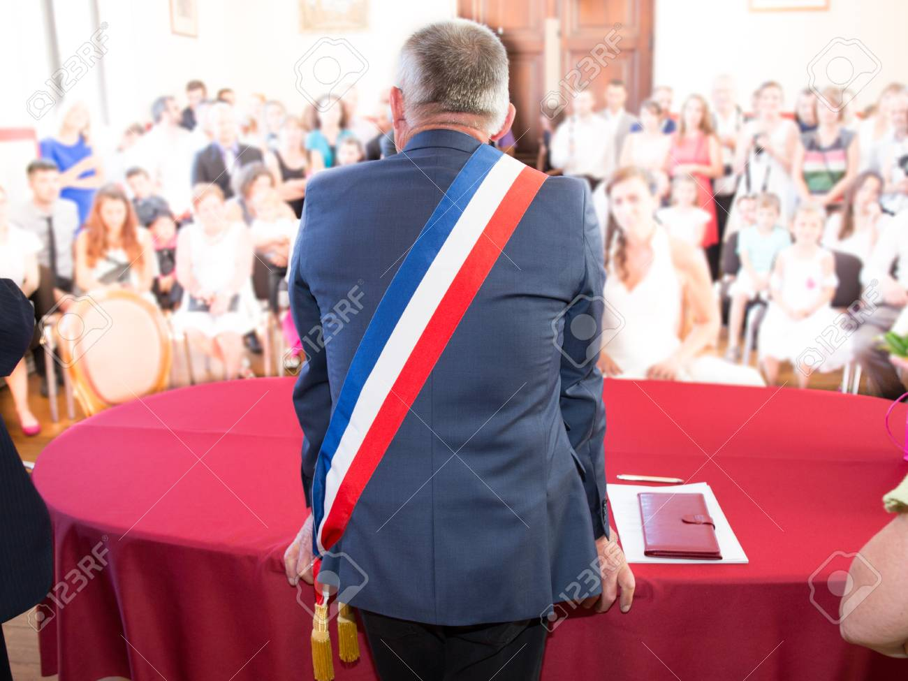 Back of French mayor with a scarf flag - 65723687