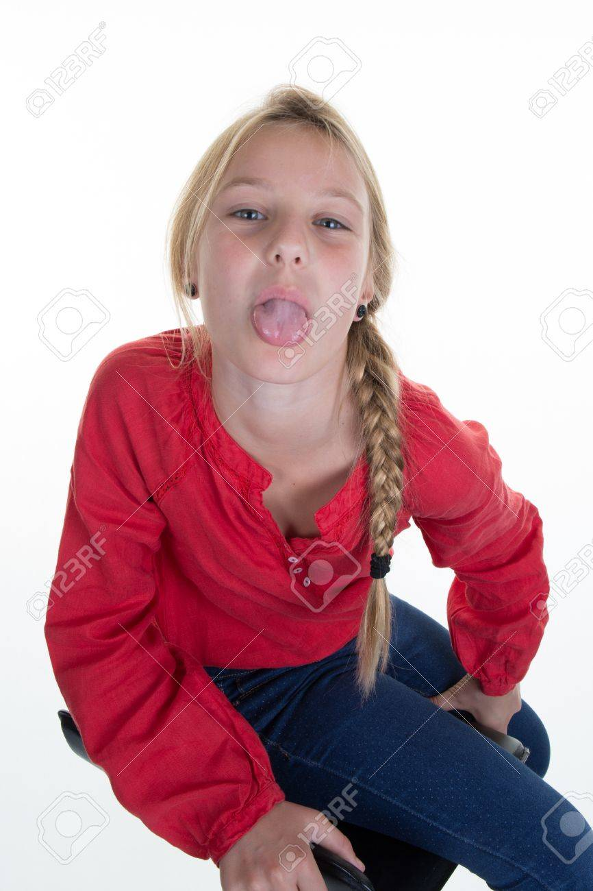 Pretty blond pre teen showing her tongue